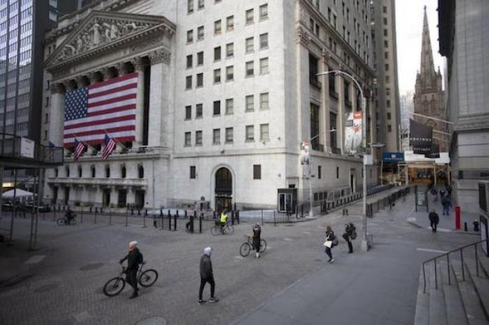 Wall Street abre levemente a la baja, pese a desaparición de nóminas